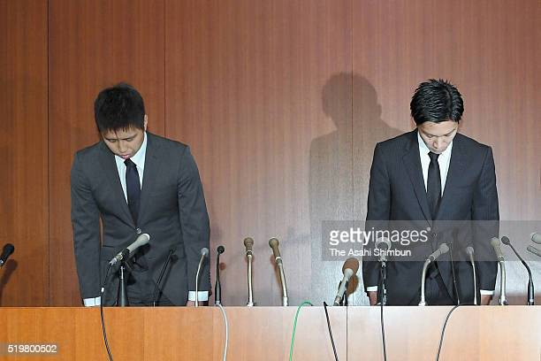 Badminton players Kenichi Tago and Kento Momota bow at the start of a press conference on April 8 2016 in Tokyo Japan Both players admitted to have...