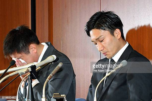 Badminton players Kenichi Tago wipes his eyes and Kento Momota looks on during a press conference on April 8 2016 in Tokyo Japan Both players...