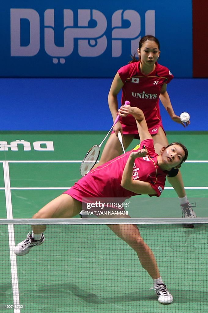 Badminton players <a gi-track='captionPersonalityLinkClicked' href=/galleries/search?phrase=Misaki+Matsutomo&family=editorial&specificpeople=6831788 ng-click='$event.stopPropagation()'>Misaki Matsutomo</a> (top) and <a gi-track='captionPersonalityLinkClicked' href=/galleries/search?phrase=Ayaka+Takahashi&family=editorial&specificpeople=8671069 ng-click='$event.stopPropagation()'>Ayaka Takahashi</a> of Japan in action during their final women's double match against Tian Qing and Zhao Yunlei of China as part of the BWF Destination Dubai World Superseries Finals at Hamdan Sports Complex in Dubai on December 21, 2014. AFP PHOTO / MARWAN NAAMANI