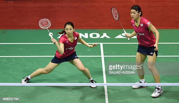 Badminton players Misaki Matsutomo and Ayaka Takahashi of Japan play against Luo Yu and Luo Ying of China during their women's doubles badminton...