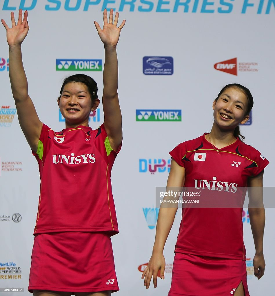 Badminton players <a gi-track='captionPersonalityLinkClicked' href=/galleries/search?phrase=Misaki+Matsutomo&family=editorial&specificpeople=6831788 ng-click='$event.stopPropagation()'>Misaki Matsutomo</a> (R) and <a gi-track='captionPersonalityLinkClicked' href=/galleries/search?phrase=Ayaka+Takahashi&family=editorial&specificpeople=8671069 ng-click='$event.stopPropagation()'>Ayaka Takahashi</a> of Japan wave to the crowd as they stand on the podium after beating <a gi-track='captionPersonalityLinkClicked' href=/galleries/search?phrase=Tian+Qing&family=editorial&specificpeople=2296575 ng-click='$event.stopPropagation()'>Tian Qing</a> and Zhao Yunlei of China in the women's doubles final match as part of the BWF Destination Dubai World Superseries Finals at Hamdan Sports Complex in Dubai on December 21, 2014.