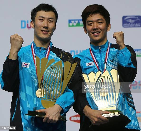Badminton players Yoo Yeonseong and Lee Yongdae of Korea pose with their trophies after winning the final of men's double at the BWF Destination...