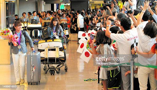 Badminton Women's Doubles silver medalists Mizuki Fujii and Reika Kakiiwa are welcomed upon arrival at Narita International Airport on August 7 2012...