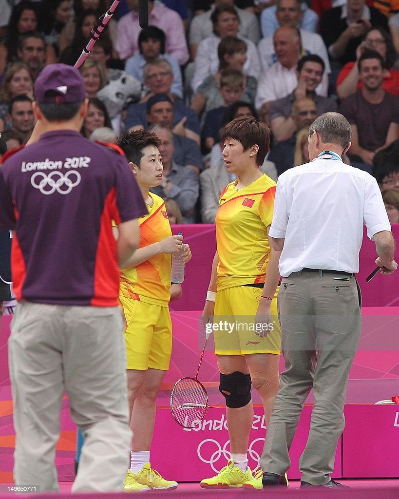 Badminton World Federation (BWF) referee Torsten Berg (R) alerts China's Yu Yang (2dL) and Wang Xioli (2dR) during their women's double badminton match against South Korea's Jung Kyun Eun and Kim Ha Na to play fairly at the London 2012 Olympic Games in London. Both pairs have beeen disqualified due to their conduct during this match.