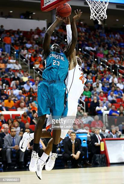 Badou Diagne of the Coastal Carolina Chanticleers goes up against Akil Mitchell of the Virginia Cavaliers in the first half during the Second Round...