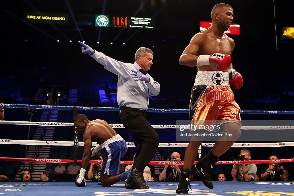 Badou Jack knocks down Michael Gbenga as referee Russell Mora tells Jack to go to his corner in their light heavyweight bout at the MGM Grand Garden Arena on May 4, 2013 in Las Vegas, Nevada.