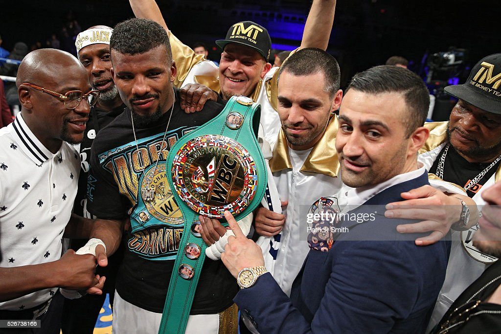 Badou Jack of Sweden talks to Floyd Mayweather (left) after a draw against Lucian Bute (not pictured) in their WBC super middleweight championship bout at the DC Armory on April 30, 2016 in Washington, DC.