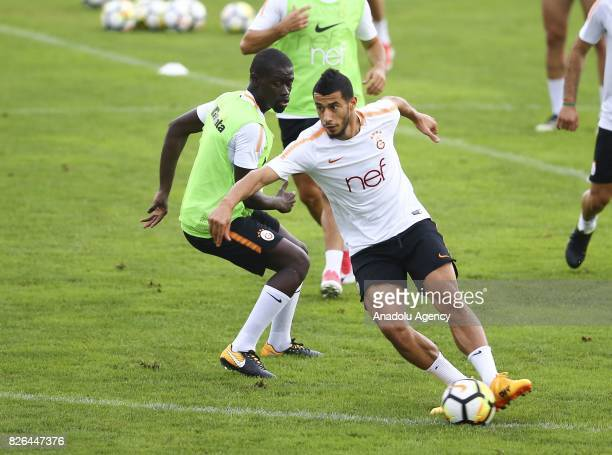 Badou Ndiaye and Younes Belhanda of Galatasaray attends a training session in Bad Waltersdor town of Graz Austria on August 04 2017