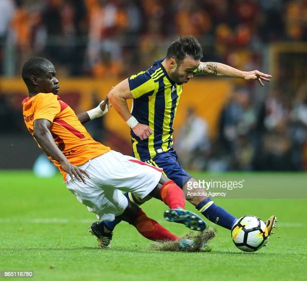 Badou Ndiaye of Galatasaray in action against Mathieu Valbuena of Fenerbahce during the Turkish Super Lig match between Galatasaray and Fenerbahce at...