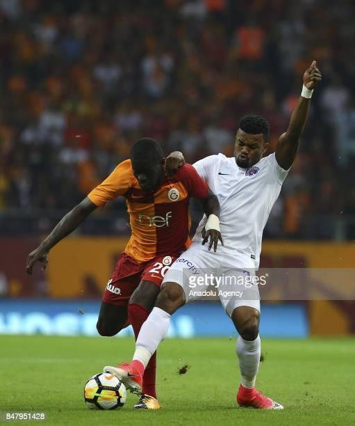 Badou Ndiaye of Galatasaray in action against Samuel Eduok of Kasimpasa during the fifth week of Turkish Super Lig soccer match between Galatasaray...