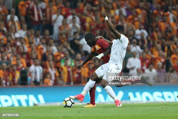 Badou Ndiaye of Galatasaray in action against Samuel Eduok of Kasimpasa during the fifth week of the Turkish Super Lig match between Galatasaray and...