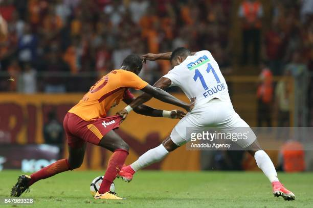 Badou Ndiaye of Galatasaray in action against Samuel Eduok of Kasimpasa during the fifth week of the Turkish Super Lig soccer match between...