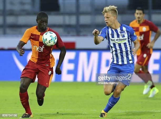 Badou Ndiaye of Galatasaray vies with Fabian of Hertha Berlin during a friendly match between Galatasaray and Hertha Berlin as part of the Turkish...