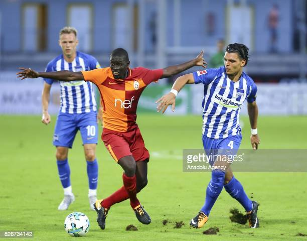 Badou Ndiaye of Galatasaray vies with Rekik Karim of Hertha Berlin during a friendly match between Galatasaray and Hertha Berlin as part of the...