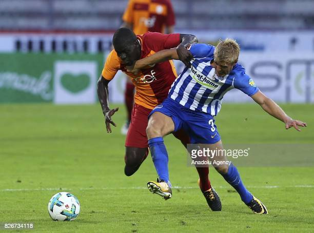 Badou Ndiaye of Galatasaray vies with Skjelberd of Hertha Berlib during a friendly match between Galatasaray and Hertha Berlin as part of the Turkish...