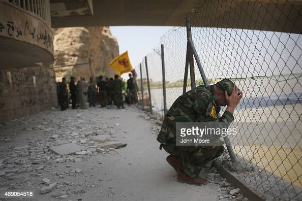 Badr Brigade militia soldier mourns along the Tigris River in the palace compound of former Iraqi President Saddam Hussein on April 9 2015 in Tikrit...