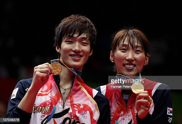 Baekcheol Shin and Hyojung Lee of South Korea celebrate winnning gold in the Mixed Doubles Final Match against Nan Zhang and Yunlei Zhao at Tainhe...