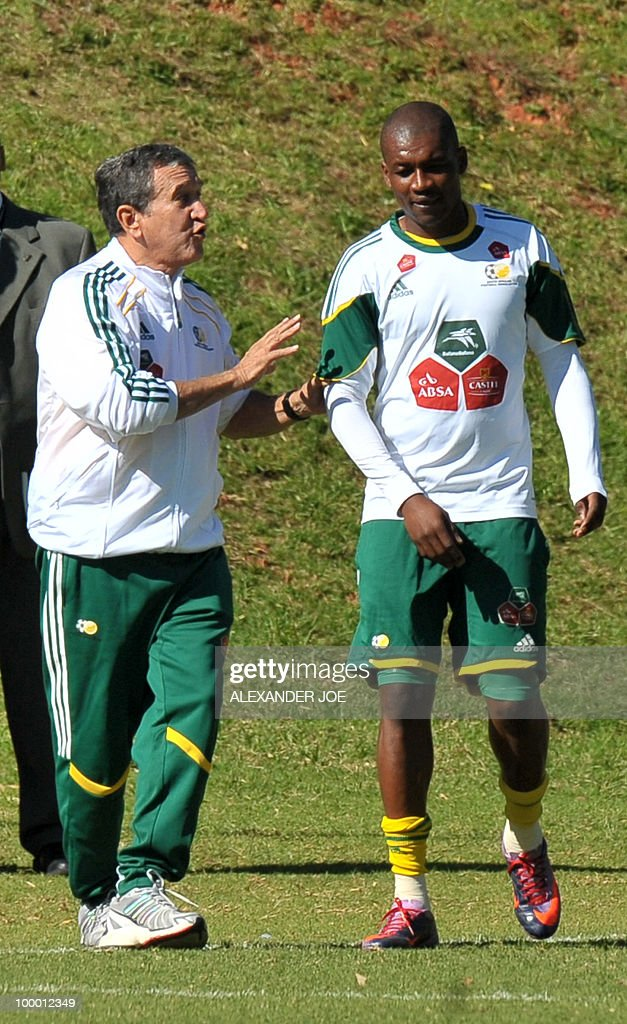 Bafana Bafana (The Boys, nickname of the South African national football team) coach Carlos Alberto Parreira speaks with Katlego Mphela during a training session in Johannesburg on May 20, 2010. South Africa occupy Group A with former winners France as well as Uruguay and Mexico, all top-20 national teams in the latest rankings from world rulers FIFA.