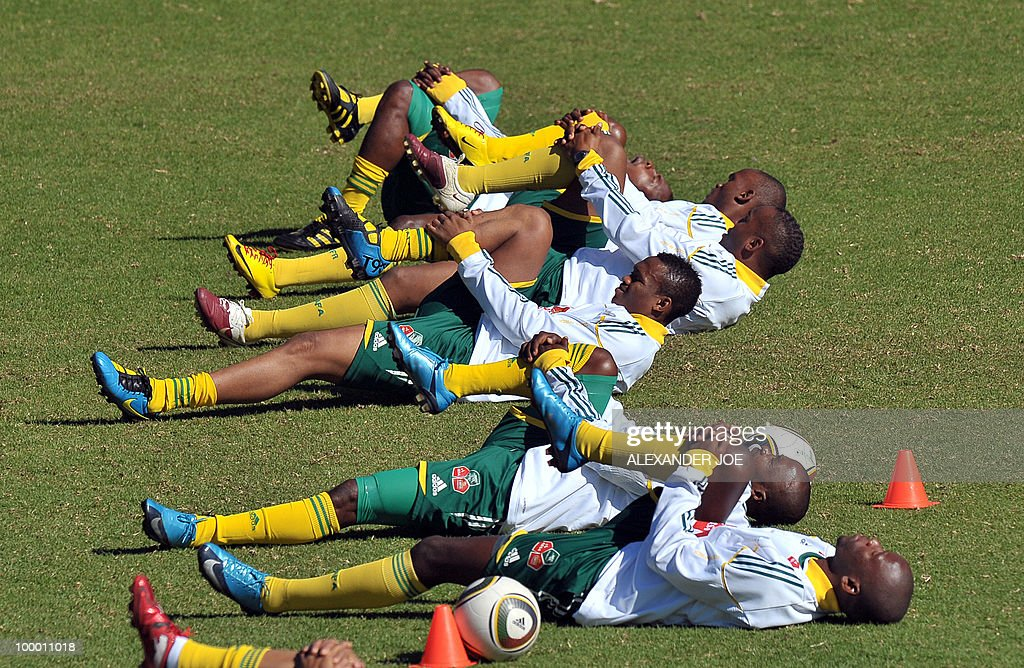 Bafana Bafana (The Boys, nickname of the South African national football team) members stretch during a training session in Johannesburg on May 20, 2010. South Africa occupy Group A with former winners France as well as Uruguay and Mexico, all top-20 national teams in the latest rankings from world rulers FIFA.