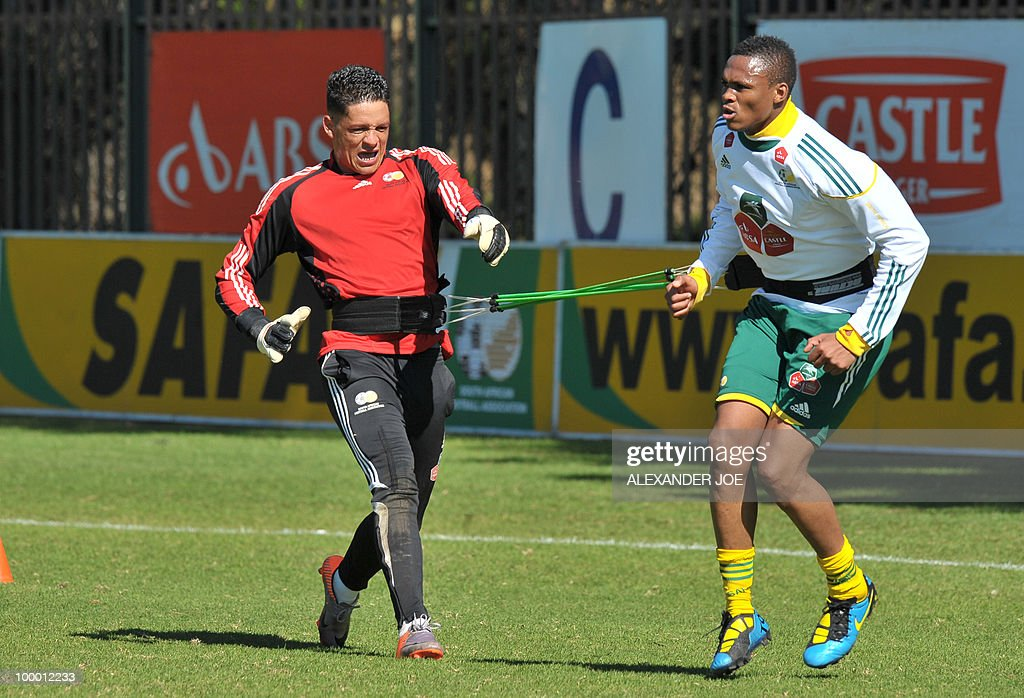 Bafana Bafana (The Boys, nickname of the South African national football team) Moeneeb Josepha (L) tries to pull back an unidentified team mate during a training session in Johannesburg on May 20, 2010. South Africa occupy Group A with former winners France as well as Uruguay and Mexico, all top-20 national teams in the latest rankings from world rulers FIFA.