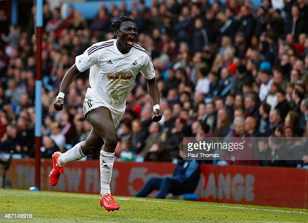 Bafetibis Gomis of Swansea City celebrates scoring the winning goal during the Barclays Premier League match between Aston Villa and Swansea City at...