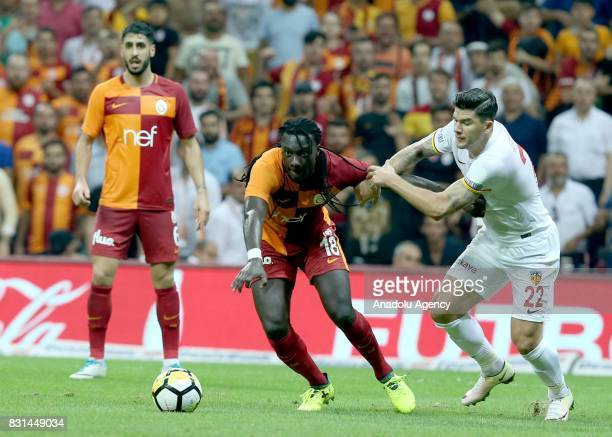 Bafetimbi Gomis of Galatasaray in action against Cristian Sapunaru of Kayserispor during a Turkish Spor Toto Super Lig soccer match between...