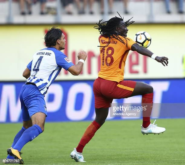 Bafetimbi Gomis of Galatasaray vies with Karim Rekik of Hertha Berlin during a friendly match between Galatasaray and Hertha Berlin as part of the...