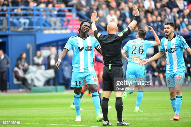 Bafetimbi Gomis of Marseille complains to referee Amaury Delerue after his goal is ruled out for offside during the French Ligue 1 match between Caen...