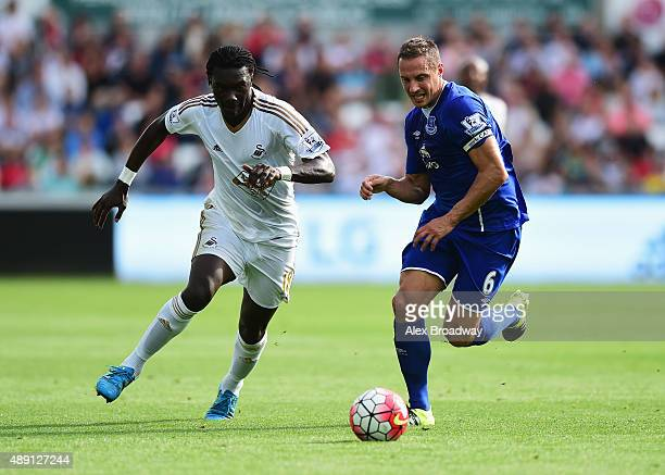 Bafetimbi Gomis of Swansea City and Phil Jagielka of Everton compete for the ball during the Barclays Premier League match between Swansea City and...
