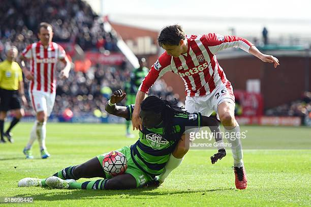 Bafetimbi Gomis of Swansea City and Philipp Wollscheid of Stoke City compete for the ball during the Barclays Premier League match between Stoke City...