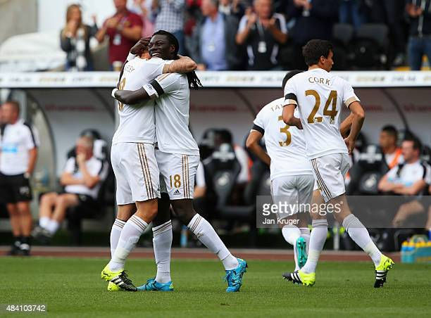 Bafetimbi Gomis of Swansea City celebrates scoring his team's first goal during the Barclays Premier League match between Swansea City and Newcastle...