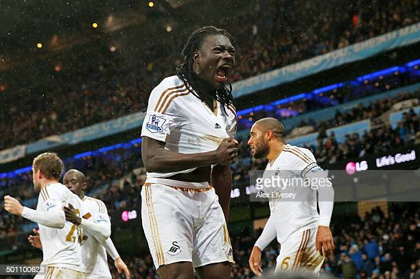 Bafetimbi Gomis of Swansea City celebrates scoring his team's first goal during the Barclays Premier League match between Manchester City and Swansea...