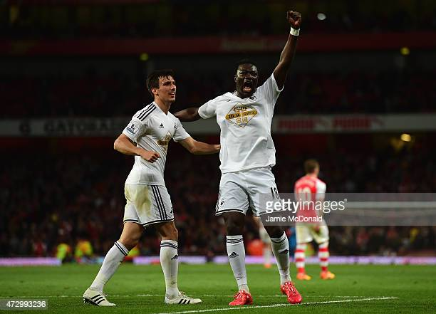 Bafetimbi Gomis of Swansea City celebrates scoring the opening goal with Jack Cork of Swansea City during the Barclays Premier League match between...