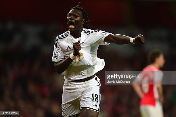 Bafetimbi Gomis of Swansea City celebrates scoring the opening goal during the Barclays Premier League match between Arsenal and Swansea City at...