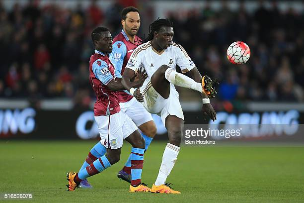 Bafetimbi Gomis of Swansea City controls the ball under pressure of Idrissa Gueye of Aston Villa during the Barclays Premier League match between...