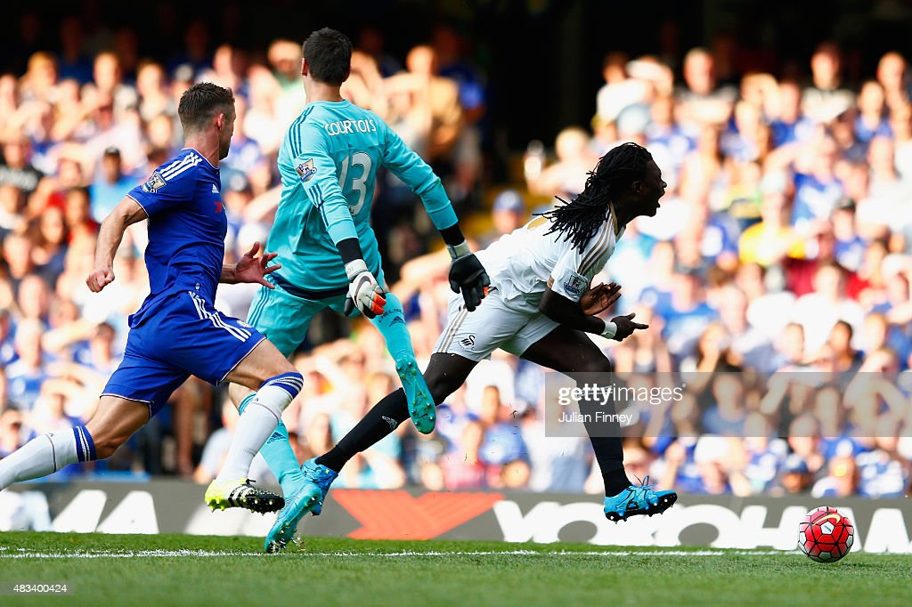 Bafetimbi Gomis of Swansea City is brought down by Thibaut Courtois of Chelsea resulting in a penalty during the Barclays Premier League match between Chelsea and Swansea City at Stamford Bridge on August 8, 2015 in London, England.