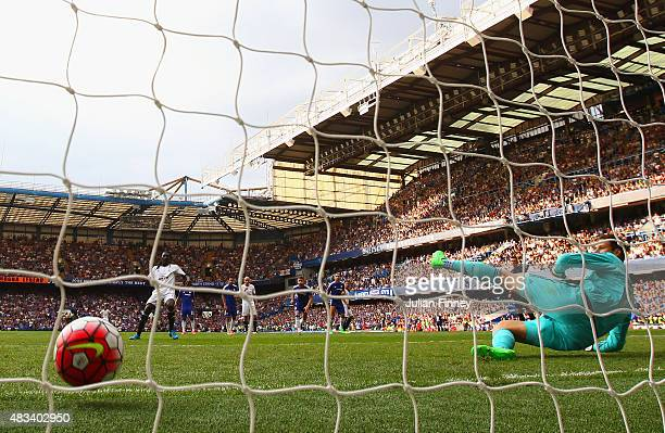 Bafetimbi Gomis of Swansea City scores his team's second goal from the penalty spot past Asmir Begovic of Chelsea during the Barclays Premier League...