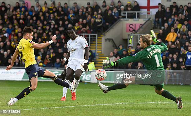 Bafetimbi Gomis of Swansea City shoots past goalkeeper Sam Slocombe of Oxford United to score his team's second goal during The Emirates FA Cup third...