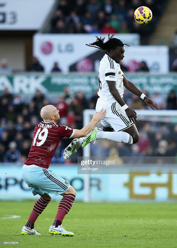 <a gi-track='captionPersonalityLinkClicked' href=/galleries/search?phrase=Bafetimbi+Gomis&family=editorial&specificpeople=686005 ng-click='$event.stopPropagation()'>Bafetimbi Gomis</a> of Swansea City wins a header with <a gi-track='captionPersonalityLinkClicked' href=/galleries/search?phrase=James+Collins+-+Welsh+Soccer+Player&family=editorial&specificpeople=15167252 ng-click='$event.stopPropagation()'>James Collins</a> of West Ham United during the Barclays Premier League match between Swansea City and West Ham United at Liberty Stadium on January 10, 2015 in Swansea, Wales.