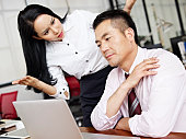 businesswoman puzzled and baffled at her male colleagues behavior.
