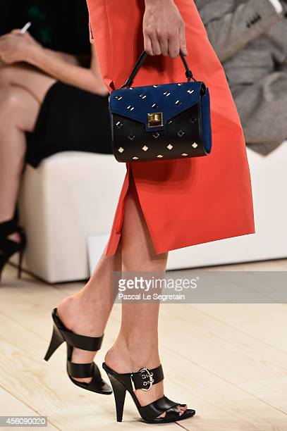 A bag and shoe details are seen as a model walks the runway during the Nina Ricci show as part of the Paris Fashion Week Womenswear Spring/Summer...