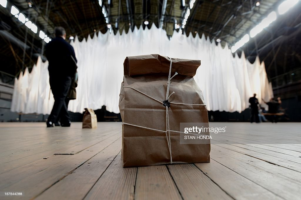 A bag containing a wireless speaker projects the voices of people doing live readings in artist Ann Hamilton's 'the event of a thread' large-scale multimedia installation at the Park Avenue Armory on December 4, 2012 in New York. The installation incorporates readings, sound, 42 swings and other live elements including 42 homing pigeons and a large billowing cloth. AFP PHOTO/Stan HONDA