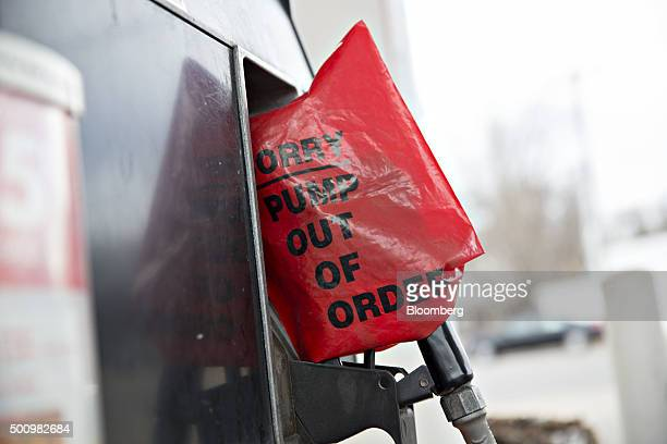 A bag covers an out of order pump at a gas station in Chilicothe Illinois US on Friday Dec 11 2015 The cost of a gallon of regular gasoline fell 67...