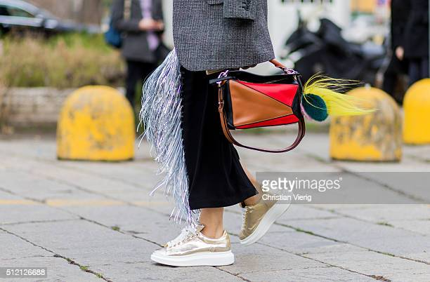 A bag detail and golden sneaker seen outside Gucci during Milan Fashion Week Fall/Winter 2016/17 on February 24 2016 in Milan Italy