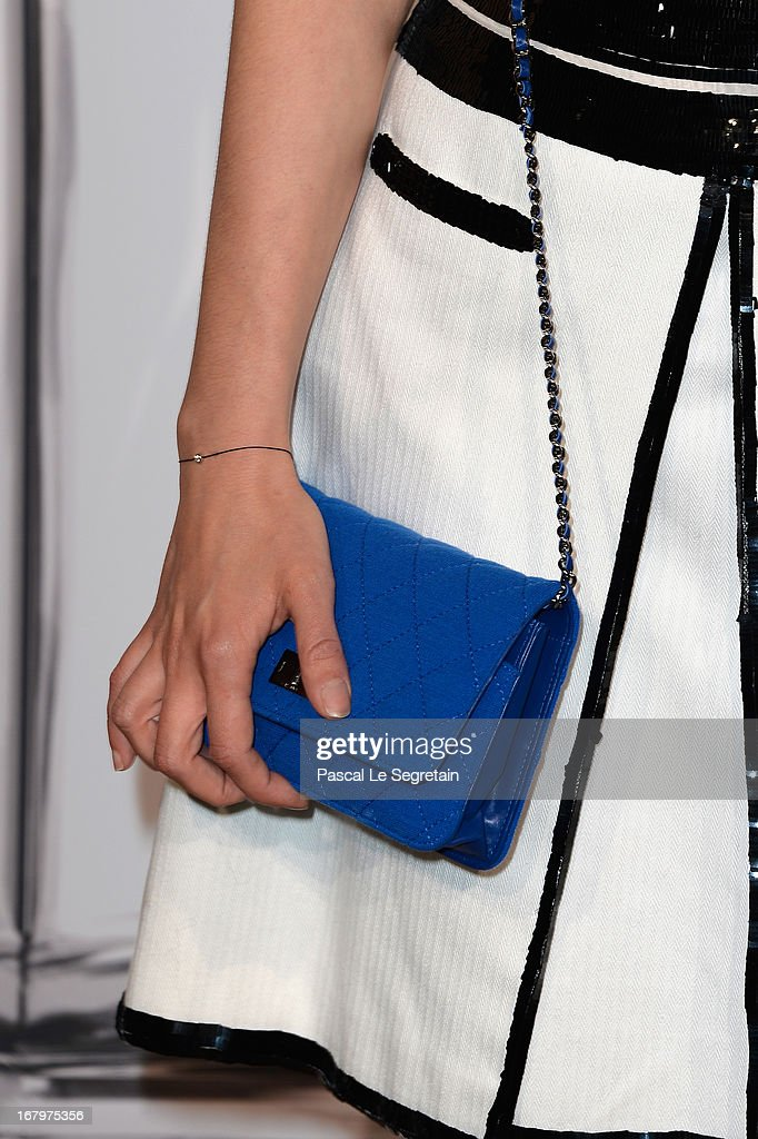 A bag detail is seen as Astrid Berges Frisbey poses during a photocall for 'N°5 Culture Chanel' exhibition at Palais De Tokyo on May 3, 2013 in Paris, France.