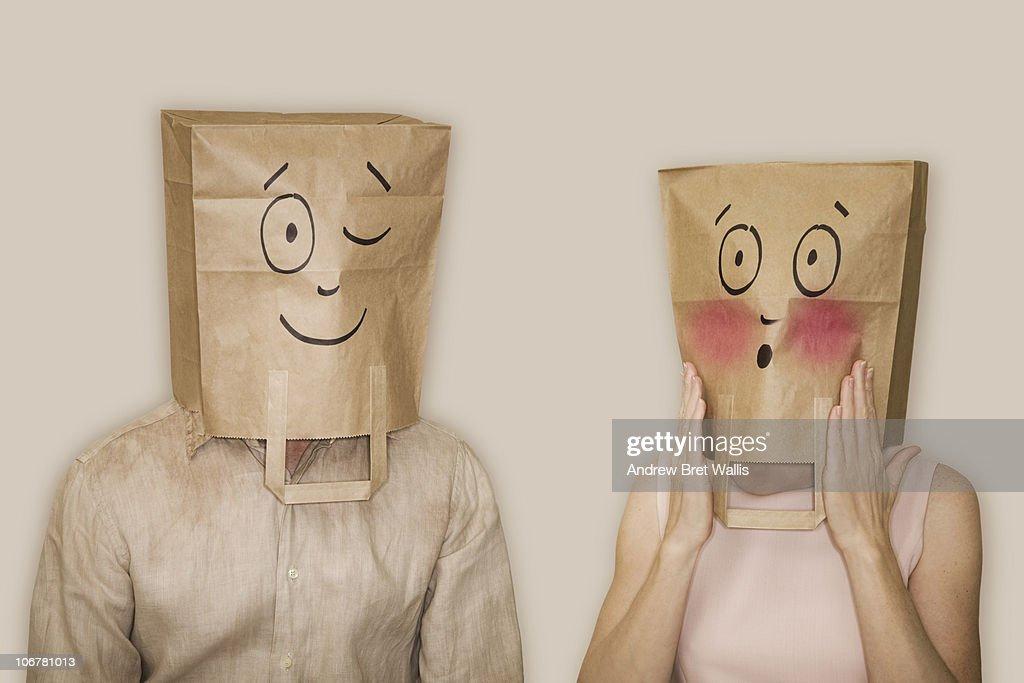 bag headed man winking, bag headed woman blushing