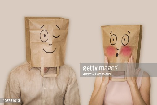 bag headed man winking, bag headed woman blushing