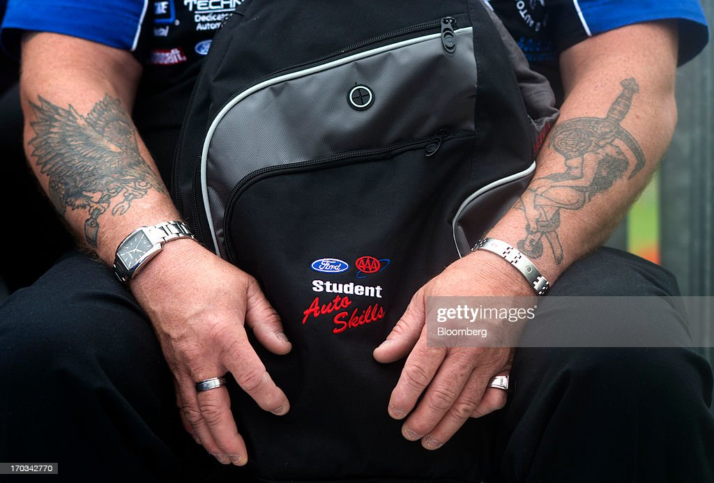 A bag is held on an instructors lap at the National Finals of the Annual Ford/AAA Student Auto Skills Competition at the Ford Motor Co. World Headquarters in Dearborn, Michigan, U.S., on Tuesday, June 11, 2013. Job openings in the U.S. fell in April, showing companies were waiting to assess the effects of higher taxes and reduced government spending before committing to bigger staff increases. Photographer: Ty Wright/Bloomberg via Getty Images