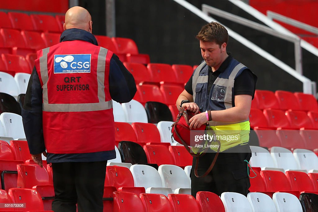 http://media.gettyimages.com/photos/bag-is-searched-in-the-stands-prior-to-the-match-being-abandoned-with-picture-id531573306