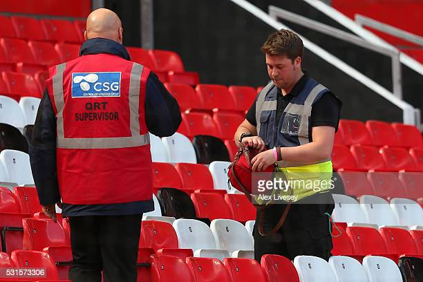 A bag is searched in the stands prior to the match being abandoned with fans evacuated from the ground prior to the Barclays Premier League match...